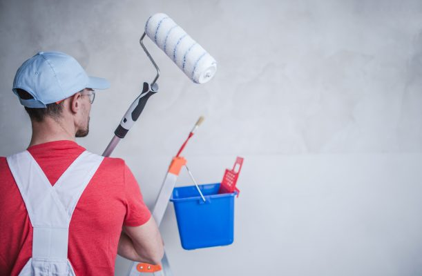 Super Trade Services - Man rolling paint on wall