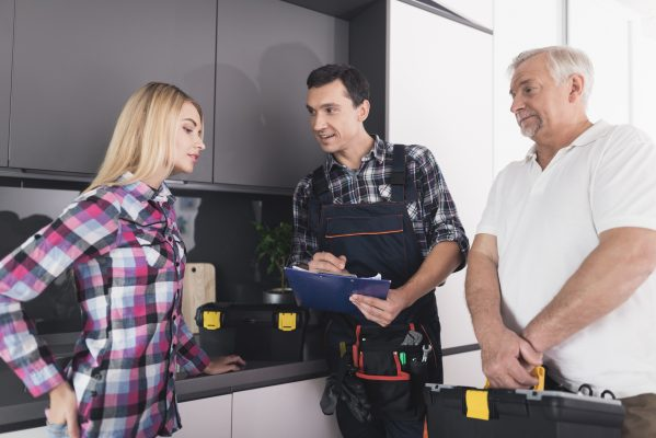 Super Trade Services - female customer with friendly plumbers