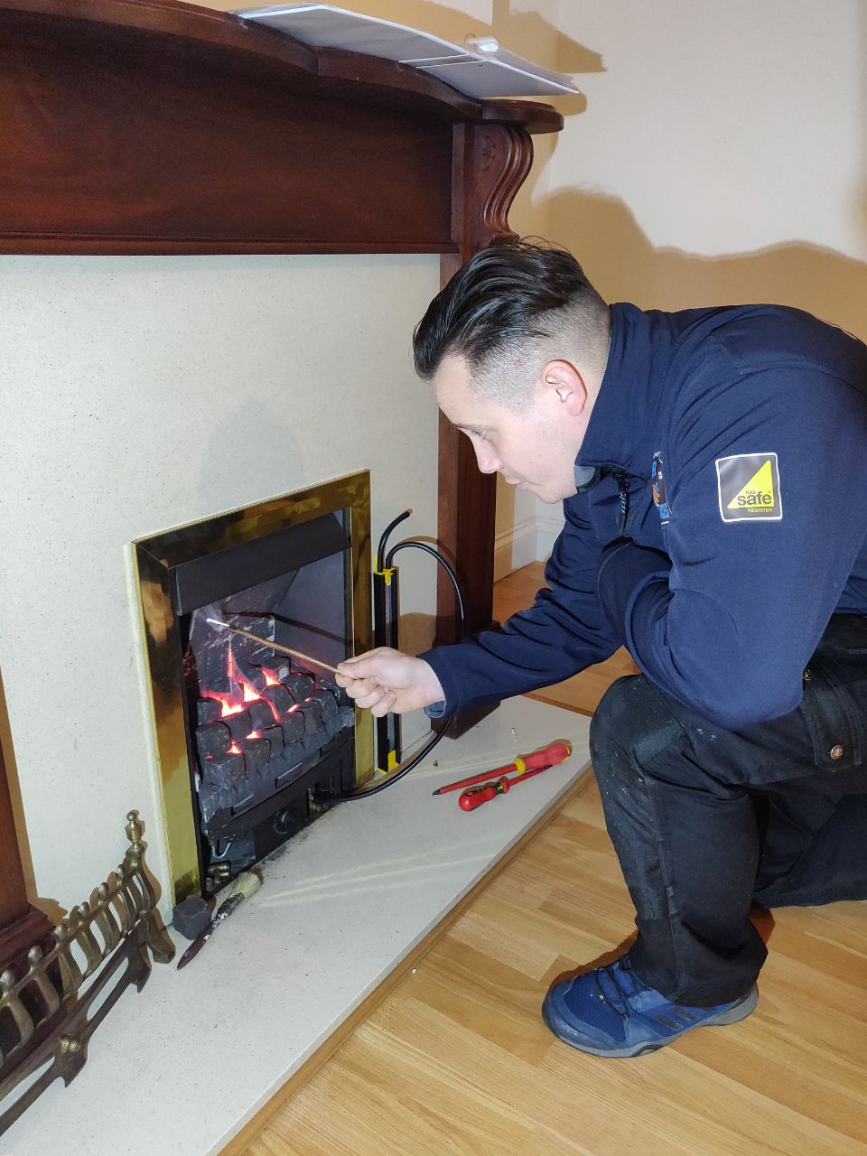 Gas man carrying out a spillage test