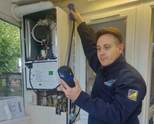 Gas engineer using a flue gas analyser
